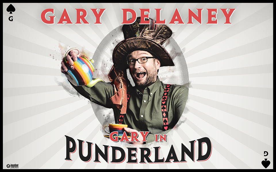 Gary Delaney wears a mad-hatter's style hat and pours tea into a cup from a stripey teapot.